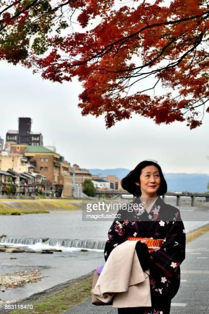 Japanese Woman in Kimono Walking along Kamo River, Kyoto