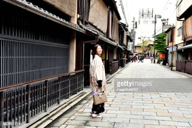 japanese woman in kimono walking in old section of kyoto - obi sash stock pictures, royalty-free photos & images