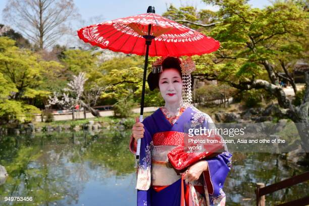Japanese Woman in Maiko's Costume and Hairstyle Enjoying Kyoto's Spring