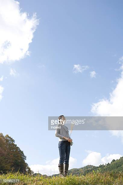 Japanese woman in outdoor, looking up