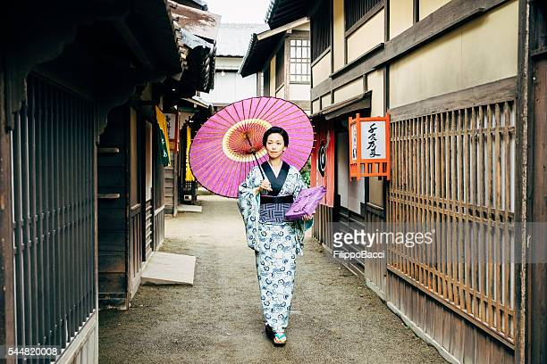 Japanese Woman In Traditional Clothes Walking in Kyoto