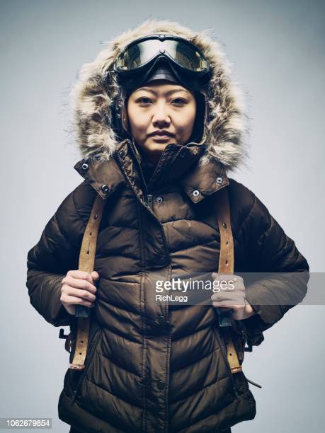 japanese woman in winter parka - parka coat stock photos and pictures