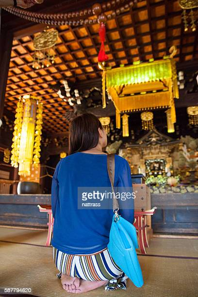 Japanese woman inside a buddhist temple