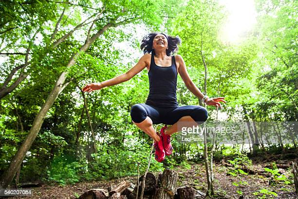 japanese woman jumping in mountain in kyoto city - lypsekyo16 stock pictures, royalty-free photos & images