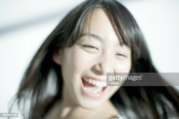 Japanese woman laughing, portrait
