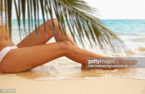 japanese woman laying on beach - hot legs stock photos and pictures