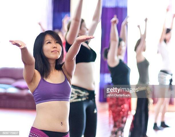 japanese woman learning belly dance - belly dancing stock photos and pictures