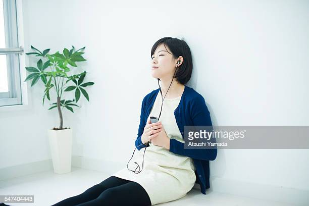 Japanese woman listening to music