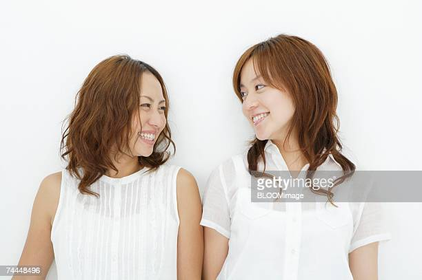 Japanese woman looking at face each other with smiling