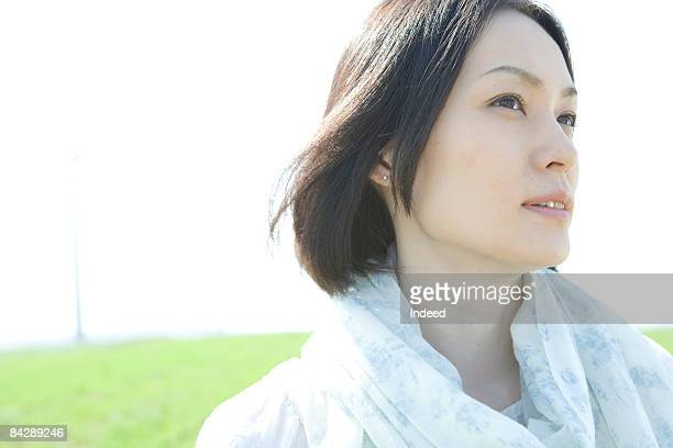 Japanese woman looking away on grass
