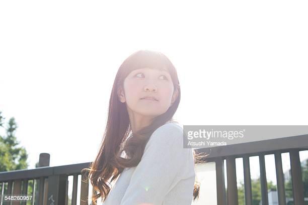 Japanese woman looking back on street