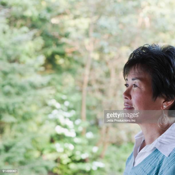 Japanese woman looking pensive