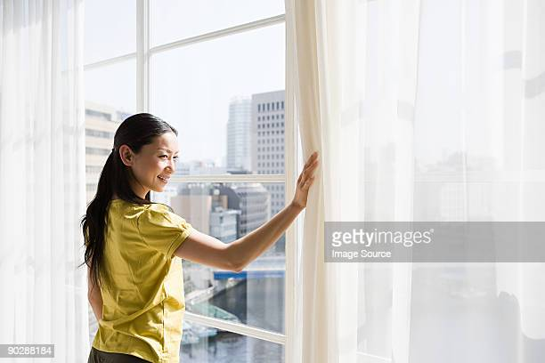 Japanese woman looking through a window