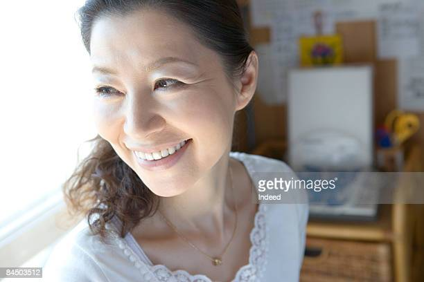 Japanese woman looking throw window, close up