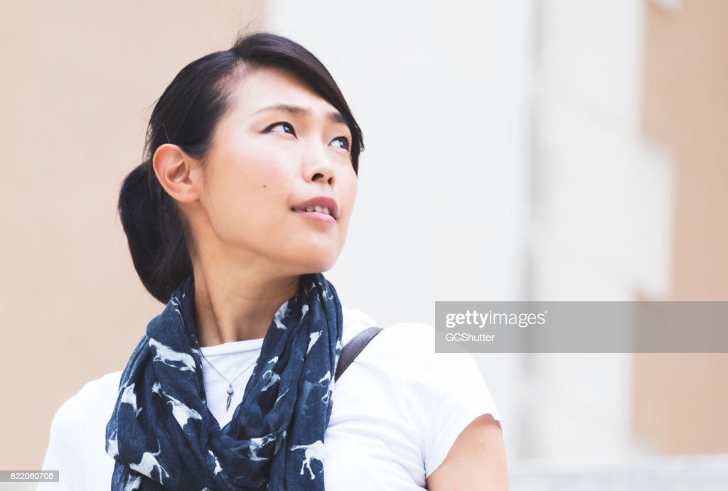 Japanese woman looking to the future : Stock Photo