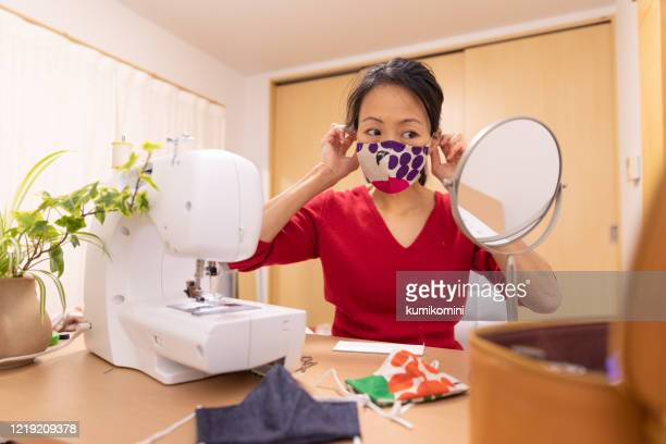 japanese woman making mask at home - cloth mask stock pictures, royalty-free photos & images