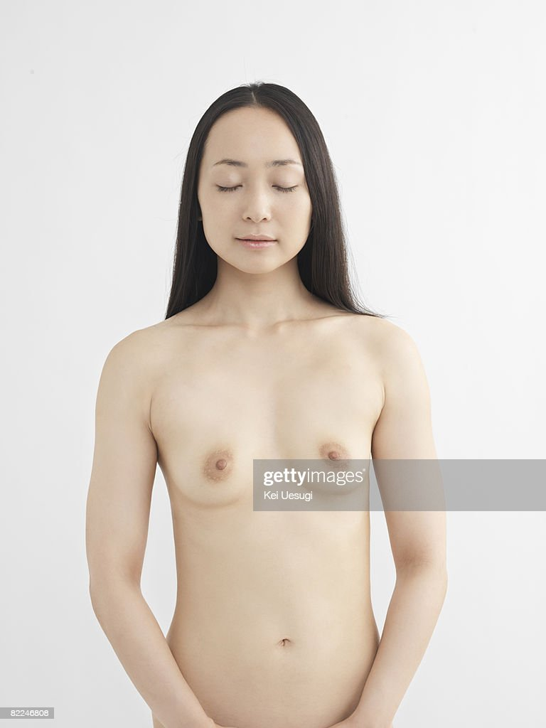 Japanese woman, nude, eyes closed : Stock Photo