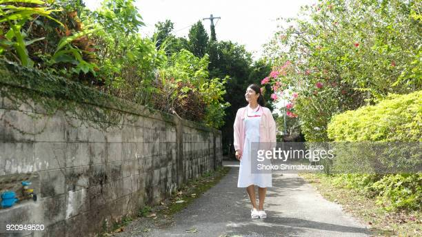 a japanese woman of medical medical doctor. - nurse and portrait and white background and smiling and female and looking at camera stock pictures, royalty-free photos & images