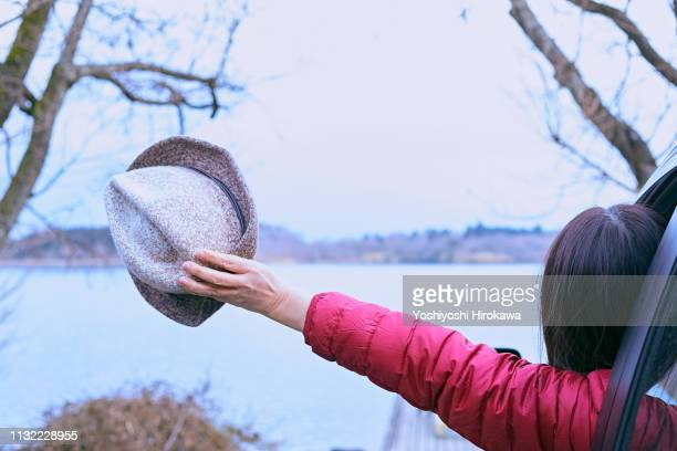 Japanese woman on journey to enjoy the scenery of the lake.