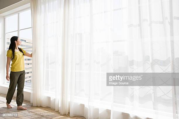 japanese woman opening net curtains - 網状 ストックフォトと画像