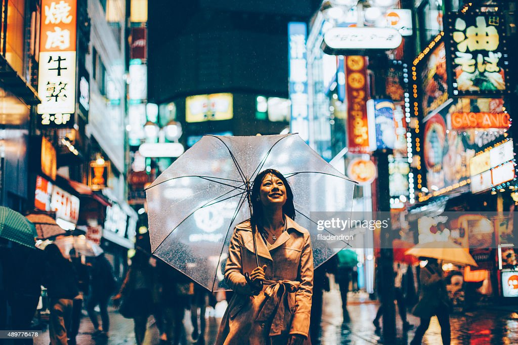 Japanese woman outside in the rain : Stock Photo
