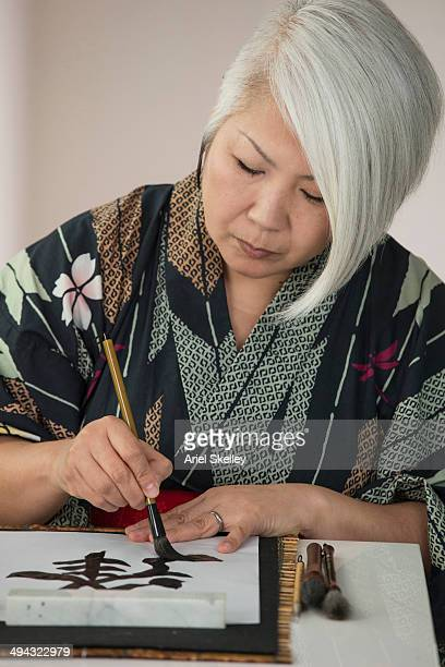 Japanese woman practicing traditional calligraphy
