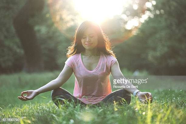 Japanese Woman Practicing Yoga Outdoors In The Early Morning