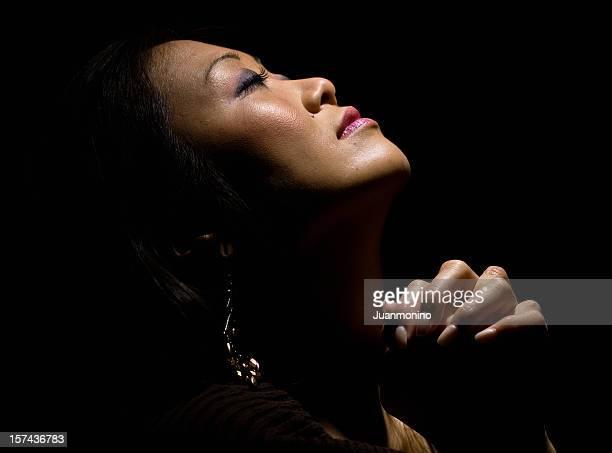 Japanese woman praying