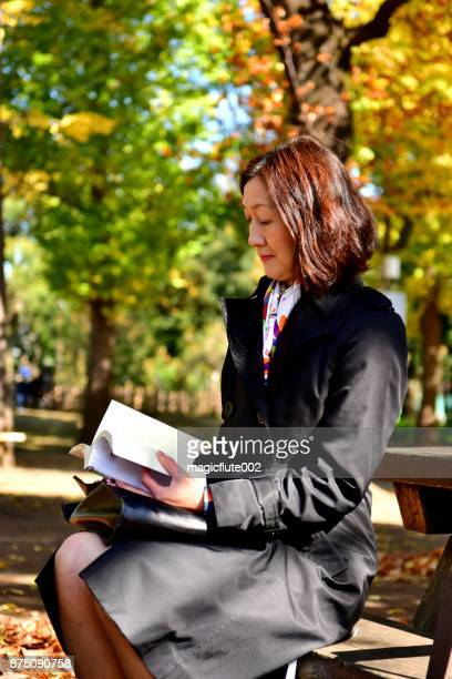 Japanese Woman Reading Book in Public Park, Tokyo