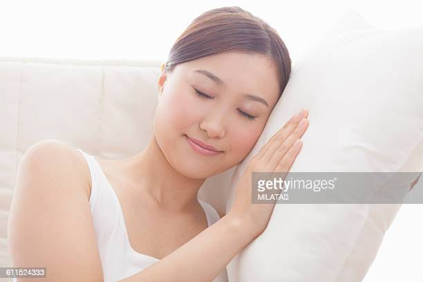 Japanese woman relaxing on the sofa