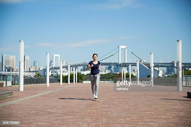 Japanese woman running early morning in Tokyo