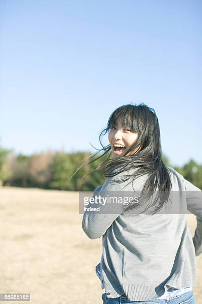 Japanese woman running, looking over shoulder