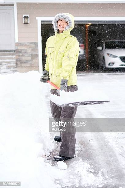 Japanese Woman Shoveling Snow