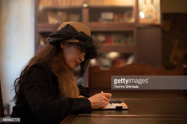 A Japanese woman siting in a old fashioned British
