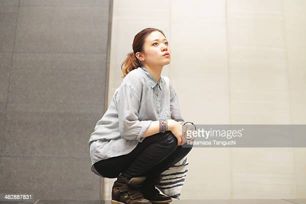 Japanese woman sitting down