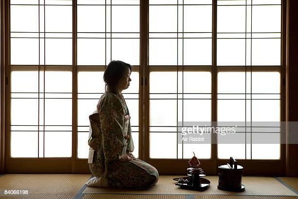 Japanese woman sitting in  tatami room