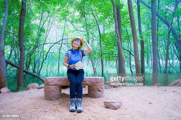 Japanese woman sitting on bench at park