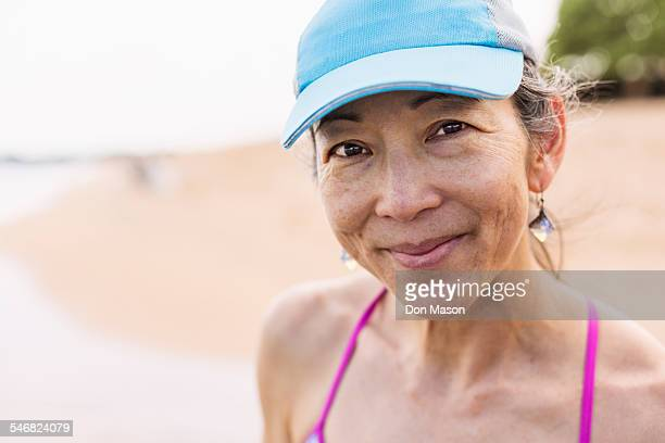 japanese woman smiling on beach - asian 50 to 55 years old woman stock photos and pictures