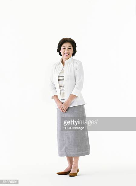 Japanese woman standing and smiling