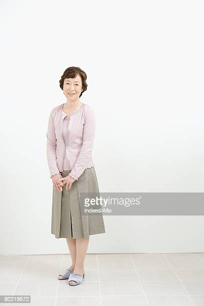 Japanese woman standing in a room