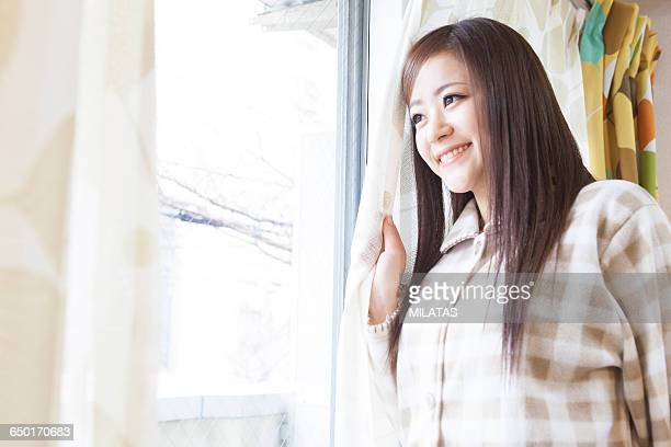 Japanese woman standing in front of the curtain