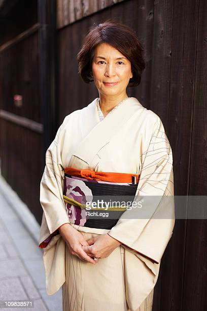 japanese woman standing on the street - kimono stock pictures, royalty-free photos & images