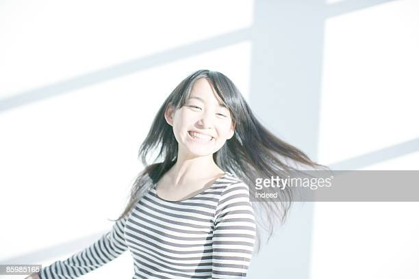 Japanese woman swinging and smiling