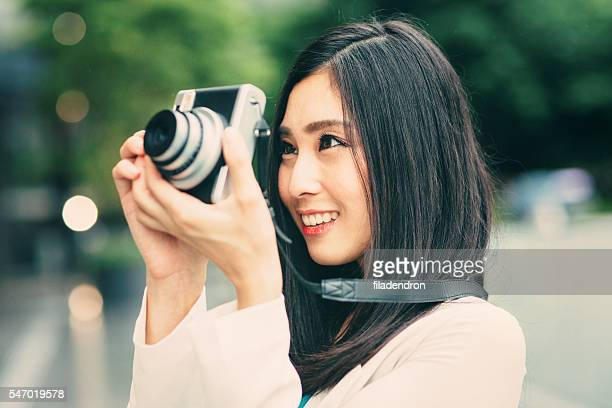 Japanese woman taking a picture