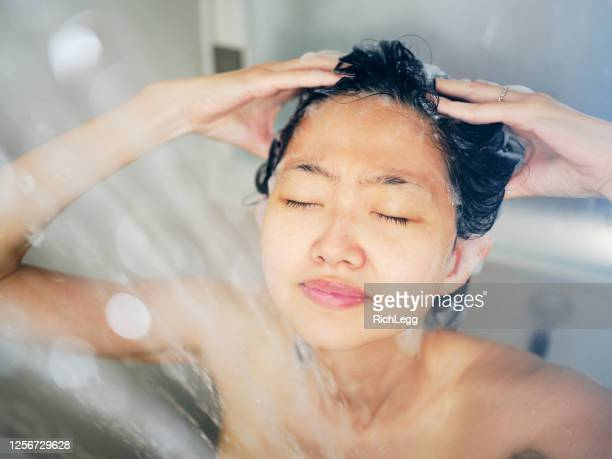 japanese woman taking a shower - washing hair stock pictures, royalty-free photos & images