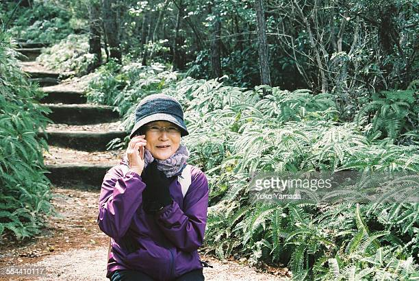 Japanese Woman Talking on Mobile Phone in Nature