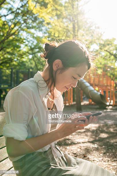 A Japanese woman touching a smartphone