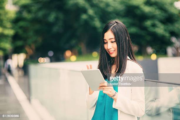 Japanese woman using a tablet