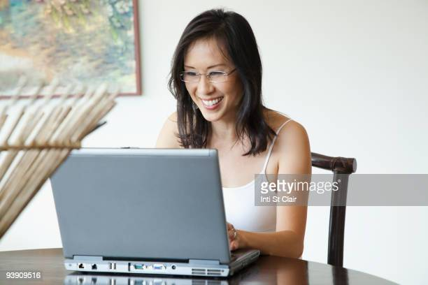 Japanese woman using laptop at table