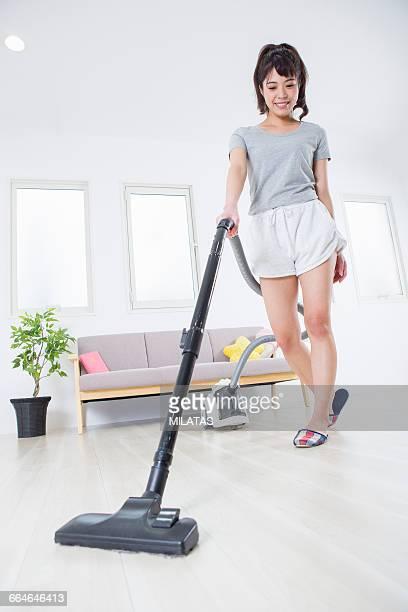 Japanese woman vacuuming